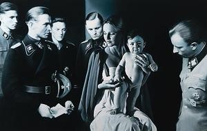 "His painting ""EPIPHANY I, The Adoration of the Magi"" provokes a protest by the widow of former Hitler Aid, SS-officer Wünsche, who appears in the painting.  Ingeborg Wünsche threatens to sue Helnwein."